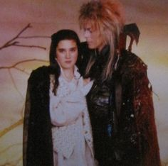 Jareth (David Bowie) and Sarah Williams (Jennifer Connelly) posing for a publicity shoot. David Bowie Labyrinth, Labyrinth Film, Labyrinth Goblins, Jim Henson Labyrinth, Jareth Labyrinth, Goblin King, Jennifer Connelly, Sarah And Jareth, Labrynth