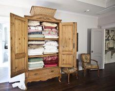 Armoire turned linen closet