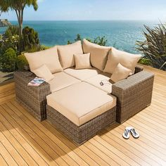 Luxury outdoor garden L shape corner sofa/settee group mocha rattan 31. Truly stunning in design, this 4 seater corner sofa gives a super high-class feel. This set consists 1 x Corner sofa piece, 2 x end pieces, 1 x large footstool, clips to hold them together, 3 x scatter cushions and heavy-duty covers in green. Call 02476 642139 or email sales@quatropi.com or visit www.quatropi.com for additional information.