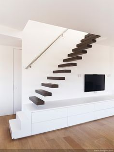 floating stairs combined with build in tv unit. love it floating stairs combined with build in tv unit. Floating Staircase, Open Staircase, Spiral Staircases, Stair Decor, Modern Stairs, Interior Stairs, House Stairs, Staircase Design, Stair Design