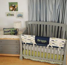 Retro Rides crib rail guard with baby's name monogrammed in green on navy fabric