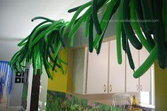 I blew up a million green balloons (with a pump) to create palm trees