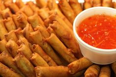Lumpia w/ sweet chili sauce and garlic vinegar sauce. Get little individual containers for dipping sauce