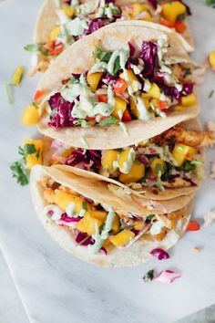 Blackened Fish Tacos with Mango Salsa, Cilantro Lime Sauce and Mexican Street Corn! It's SO good (even approved from someone who doesn't really like fish) by popular Florida lifestyle blogger Fresh Mommy Blog