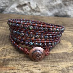 Rustic Red and Blue Faceted Czech Glass Wrap Bracelet on Natural Dyed Leather with Oxidized Copper OM Button Closure by KyaraCreations on Etsy Jewellery Diy, Handmade Jewelry Bracelets, Wrap Bracelets, Necklaces, Copper Jewelry, Leather Jewelry, Make Your Own Jewelry, Jewelry Making, Beaded Leather Wraps