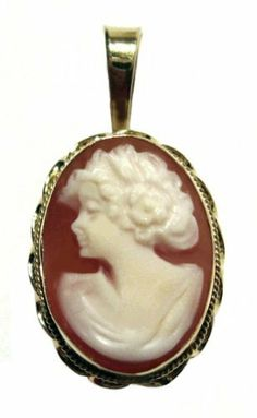 Cameo Pendant Italian 18k Yellow Gold Master Carved Carnelian Shell cameosRus. $189.00. Carnelian Conch Shell, 0.67 x 0.47 Inches, with the bale 0.98 inches,. Collector's Item, Gift, Bas Relief,. Exceptional Value, Italian, Heirloom Jewelry,. Cameo Pendant, Italian Master Carved, 18k Yellow Gold. Artisan Jewelry, One of a Kind, Museum Quality,