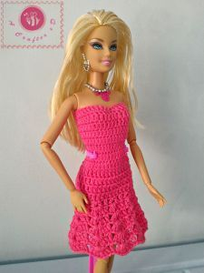 Free crochet pattern. Pattern category: Doll Clothes Barbie. Thread weight yarn. 0-150 yards. Features: Lace. Easy difficulty level.