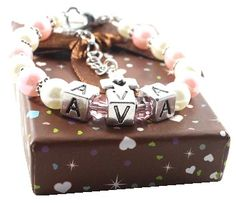 """Personalized Cross/Heart Bracelet  Bella, Bella! Gorgeous bracelet for your beautiful baby girl. Beautifully handmade with acrylic pearls, acrylic birthstones, metal spacers and a 1"""" extender with metal cross/heart using 49 strand wire in order to ensure long lasting durability altogether with an adorable heart clasp!"""