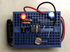 breadboard blinky prototype 02 with staples    A lot cheaper than a bag of jumpers...