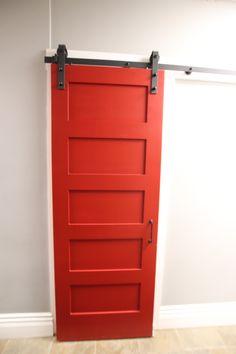 five panel bright red barn door with black hardware Custom Interior Doors, Interior Barn Doors, Barn Door Pantry, Red Barns, Kids Rooms, Basement, Garage Doors, Hardware, House Design