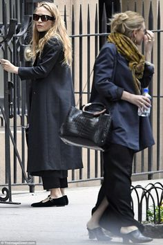 Lavish look:The 29-year-old fraternal twins were dressed similarly in dark ensembles as they carried their comparable large purses which retail for around $30,000 each