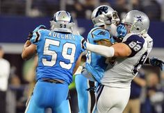 Carolina Panthers' Luke Kuechly (59) makes his second consecutive interception against the Dallas Cowboys on a pass intended for Jason Witten (82) in the first half at AT&T Stadium on Thursday, November 26, 2015. The Panthers won 33-14 and improved to 11-0.