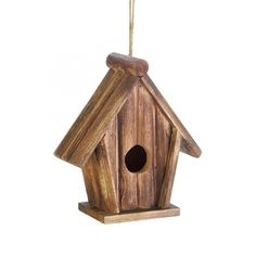 Classic Rustic Wood Birdhouse You won't be able to resist the charm of this rustic birdhouse and neither will the birds! The pitched roof and simple design makes this a wonderful addition to your favorite tree. Wooden Bird Houses, Decorative Bird Houses, Bird Houses Diy, The New Classic, Birdhouse Designs, Bird House Kits, Cabin In The Woods, Wood Bird, Kit Homes