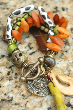 Fiji Bracelet: Exotic Amber, Green, Wood, Bone, Brass and Mixed Media Charm Bracelet