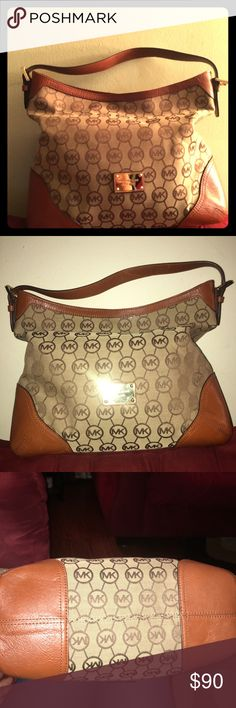 Michael kors Handbag Great condition!! Inside has minor stains due to perfume dripping in the inside.. Vut outside is in great condition.Worned about 3 to four times. 100% authenticity. Brought from Marshall's. KORS Michael Kors Bags Totes