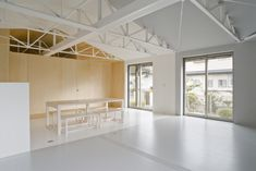 Japanese studio Epitaph have remodelled the interior of this bungalow in Iwate, Japan, by removing internal walls and exposing the roof t. Wood Truss, Roof Trusses, Studio Lighting, Contemporary Interior, Kitchen Lighting, Ceiling Lights, Interior Design, Architecture, Bed
