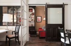 A good way to let in light and still have the cool look of a sliding barn door. DeCesare Design Group