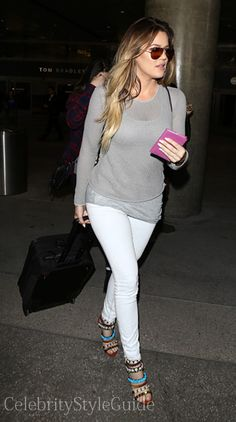 Seen on Celebrity Style Guide: Khloe Kardashian wore this grey mesh top and white skinny jeans when she and the family all arrive back in Los Angeles from a family vacation to Thailand April 2  Get Here Top Here: http://rstyle.me/~1Pozm