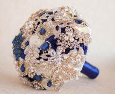 Brooch bouquet. Ivory, Navy Blue and Gold wedding brooch bouquet by MagnoliaHandmade on Etsy https://www.etsy.com/listing/291469399/brooch-bouquet-ivory-navy-blue-and-gold