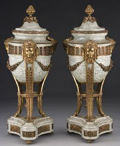 A pair of Dore bronze mounted marble cassolettes, circa 1900. Height 25""