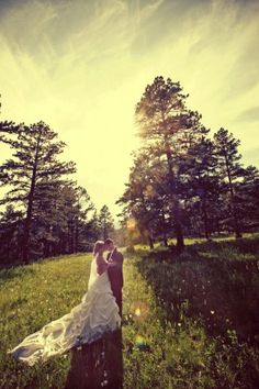 Field, Wedding Dress, mountains, forest, trees, woods, romance, antique, vintage, sunset. Weddings at Della Terra Mountain Chateau in Estes Park, Colorado.