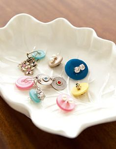 use old buttons to keep pairs of earrings together (run posts through button holes)