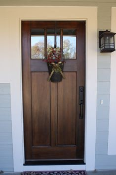 Dark wood stained door contrasting against white trim white trim