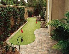 My dream backyard natural stone patio golf putting green large shaded pergola water feature -pond hot tub care-free fire pit lots of shade and antique garden decor.