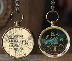 """Antique looking brass working compass with quote: """"We travel not to escape life but for life not to escape us.""""   