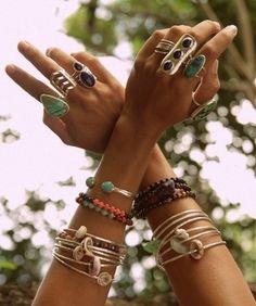 rings on her fingers.