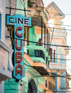 Vintage signs and colorful home and building exteriors in Havana, Cuba.