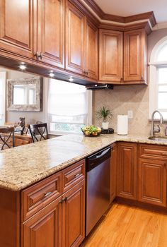 Kraftmaid ginger glaze cabinets with granite countertops for Cinnamon colored kitchen cabinets
