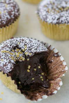 Sugar and Charm's recipe for Dark Chocolate Molten Cupcakes. A decadent and easy chocolate dessert recipe.