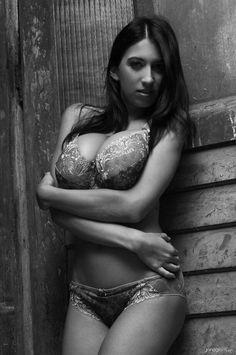Jana Defi - embroidered underwear - self-embrace pose