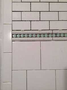 Lindsay & Drew: Penny Tile - I used mint penny round tile that I found on overstock.com. And then trimmed out the penny round tile with a beaded trim tile from lowes.