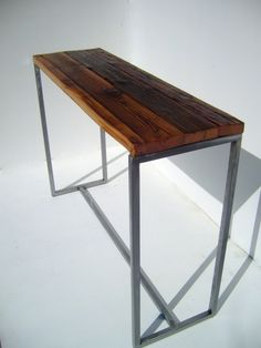 A cool reclaimed wood console table that could go behind your sofa.