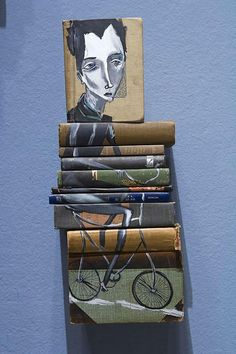How are these attached to the wall? I love it when books are art.