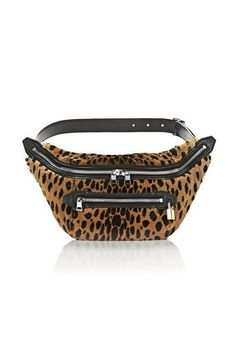 It's time to change up your idea of how to wear a fanny pack. These days, people are wearing them fastened over one shoulder and under the arm, like a crossbody.Alexander Wang Padlock Fanny Pack in Cheetah Printed Shearling, $595, available at Alexander Wang. #refinery29 http://www.refinery29.com/2016/09/124699/new-bag-trends-fall-2016#slide-3