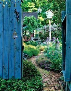 Secret garden.... like the bell and birdhouse