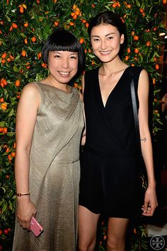 Vogue China's Angelica Cheung, left, and Amalie Gassmann, photographed by Getty Images for Tory Burch at our Paris flagship opening party