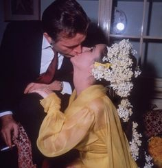 "Elizabeth Taylor and husband No. 5: Richard Burton, take 1: Just nine days after splitting from Fisher, Liz said ""I do"" to Richard Burton, her co-star in Cleopatra, in yellow chiffon and a wild floral headdress. They were married for 10 years—Liz's longest marriage—from 1964 to 1974, and adopted a daughter, Maria, in 1964."