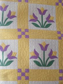 Appliqued Tulips Quilt. I don't love doing hand appliqué but this is beautiful!