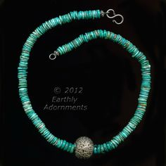 nlbd1077-Turquoise heishi necklace with heavy handworked repoussé Tibetan sterling silver bead