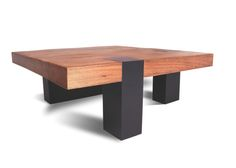 """The table top is made of a single slab of reclaimed solid Tamburil wood, playing with the visual effects provided by the placement of its asymmetrical base. The legs cross over the table top and are made of stained wood.    Customization options include finishes, reclaimed wood types, sizes, and base materials.    Dimensions: 43""""L x 43""""D x 15""""H"""