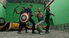 """Director Josh Whedon shows Chris Evans and the others """"how it's done""""."""