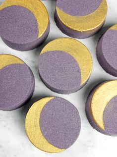 Learn how to make Crescent Moon Bath Bombs at home with coconut oil, baking soda and citric acid. A gold crescent moon is created with mica paint.