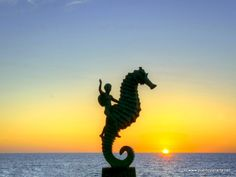 Sunset behind the famous Little Seahorse Statue in Puerto Vallarta