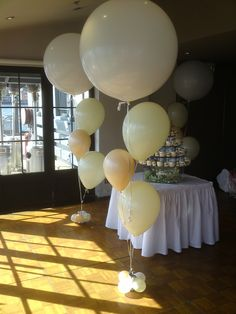 "Different sized balloons -  3ft with 16"" and 11"" in blush and ivory xx"