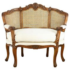 Despite its relatively modest dimensions--it's less than four feet wide--this loveseat makes a big impression. Credit the high, fanlike seat back, the elaborately carved mahogany frame, and cream linen upholstery. Settee Sofa, Upholstered Chairs, Sectional Sofa, Armchair, Sofas, Walnut Furniture, Luxury Furniture, White Furniture, Chair And A Half
