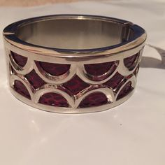 "White House Black Market silver red cream bangle Brand new with tags. Silver bangle bracelet. Red ""snake"" and cream. Opens and closes to get on/off. White House Black Market Jewelry Bracelets"
